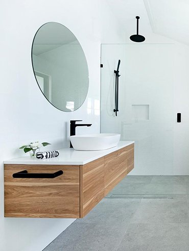 bathroom with vanity mirror and glass divider