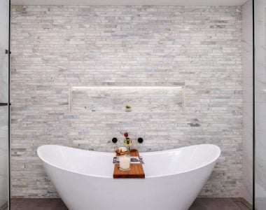 bath infront of mosiac tiles