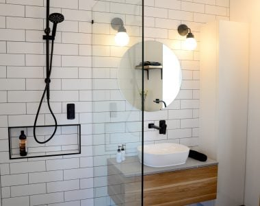 modern bathroom with white tiles and black accessories