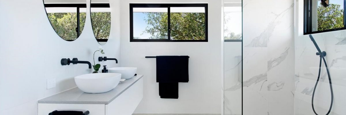 bathroom with designer tiles and mirrors
